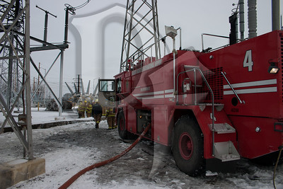 Rescue 4, a crash truck from the Greater Rochester Internetional Airport (GRIA) Fire Department, parked at the scene of a large transformer fire at an RG&E substation on January 14, 2012.