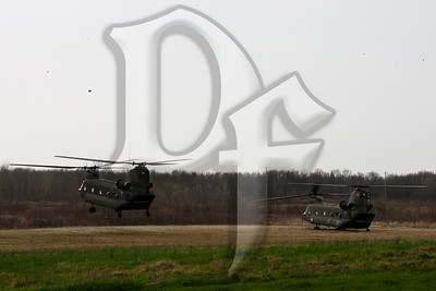 Two NY Army National Guard CH-47 Chinooks approach a landing zone in Chili, NY where they will pick up Marine Corps Reservists assigned to A Company, Anti-Terrorism Battalion, 4th Marine Division. The Chinooks are based out of the Greater Rochester International Airport and the Marines were bound for Fort Drum near Watertown, NY for their drill weekend.