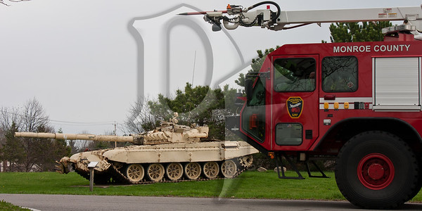 Rescue 3 from the Greater Rochester International Airport Fire Department is pictured near a Russian T-72 Battle Tank outside the Marine Corps Reserve Center in Chili, NY. The reserve center is currently home to Alpha Company of the Anti-Terrorism Battalion, 4th Marine Division but was previously home to the 8th Tank Battalion. This particular tank was captured from the Iraqi Republican Guard during Operation Desert Storm and returned to the 8th Tank Battalion for display in front of their unit headquarters. After the unit's mission changed several years ago, the Marines obtained permission to keep the tank in it's place as a reminder of the 8th Tank Battalion's history.