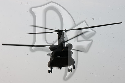 A NY Army National Guard CH-47 Chinook approaches a landing zone in Chili, NY where it will pick up Marine Corps Reservists assigned to A Company, Anti-Terrorism Battalion, 4th Marine Division. The Chinook is based out of the Greater Rochester International Airport and the Marines were bound for Fort Drum near Watertown, NY for their drill weekend.