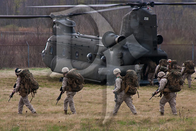 Marines of the Anti-Terrorism Battalion, A Company board a CH-47 Chinook enroute to their drill weekend at Fort Drum, NY.