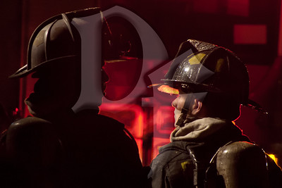 Firefighters from the City of Rochester FD operate at the scene of a house fire in Gates, NY. This fire on Varian Ln. was the second fire in the town of Gates within an hour and required extensive mutual aid. Unfortunately, both fires claimed the life of a resident. January 20, 2012.