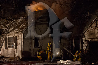 Firefighters work to control a house fire on Varian Ln. in Gates, NY. This was the second of two fatal fires reported within an hour in the town. January 20, 2012.