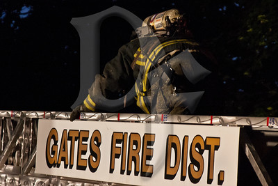 Gates firefighters operate at the scene of a working house fire on Frederick Dr. Rochester Fire Dept. Engine 7 also responded to the scene as a mutual aid company.