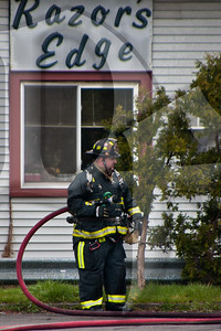 A Gates firefighter operates at the scene of a working fire.