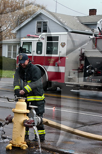 A Gates firefighter shuts down a fire hydrant used to supply water at the scene of a working fire.