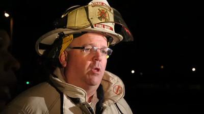 Ridge Road Battalion Chief William Timmons briefs the media
