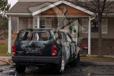 A vehicle fire on White Swan Dr. in Greece, NY produced enough heat to damage the vinyl siding on two adjacent townhomes.  2011, December 22