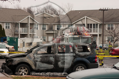 The remnants of a Dodge Durango await a Fire Investigator after being destroyed in a fire on White Swan Drive in Greece,  NY.  2011, December 22