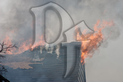 Flames shoot from the collapsed roof of the Dartmouth House Bed & Breakfast, which was destroyed by fire.