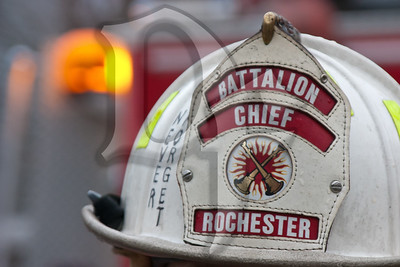The helmet of a Battalion Chief in the Rochester FD reminds us to 'never forget' at the scene of a 2-alarm house fire. This fire destroyed the Dartmouth House Bed & Breakfast.