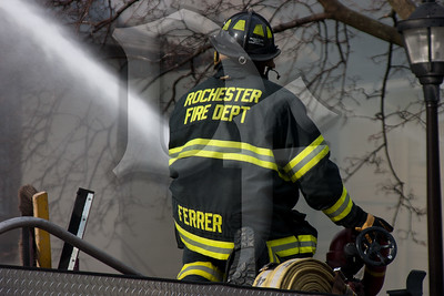 A Rochester firefighter operates a deck gun at the scene of a 2nd alarm structure fire on Dartmouth St. in the city. This house operated as a Bed & Breakfast called the Dartmouth House.