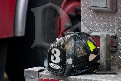 A Rochester firefighters helmet (iHelmet perhaps?) at the scene of a 2-alarm house fire at the Dartmouth House Bed & Breakfast.