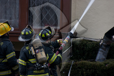 Rochester firefighters operate at the scene of a 2nd alarm structure fire on Dartmouth St. in the city. This house operated as a Bed & Breakfast called the Dartmouth House.