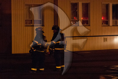 Rochester firefighters operate at the scene of a 3rd alarm building fire on Emerson St.