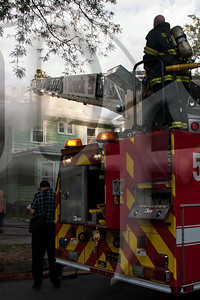 Rochester, NY firefighters operate at the scene of a working fire in a vacant house on Evangeline St. in the city. This was the second fire in about 60 minutes and was handled by several of the same crews that had just cleared the first fire. The cause of this fire is under investigation and is considered suspicious.