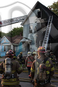 Rochester firefighters operate at the scene of a working fire in a vacant structure at 66 High St. While several companies were working at another house fire on Joseph Ave., calls began coming in for the green house on fire. First arriving companies reported heavy fire on the 'A' side of a vacant, and stated they would be stretching lines. The fire was knocked down in about a half hour and the cause is under investigation.