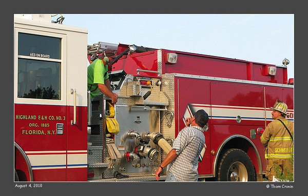 Pump operator Jeff Babock left, speaks with Warwick FD 1st Assistant Chief Dan Schweikart right, about water supply.