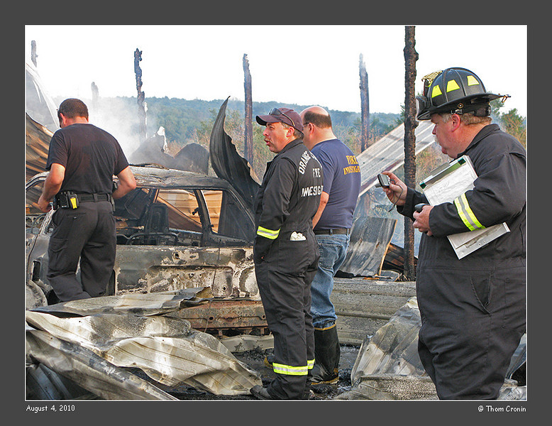 Orange County Fire Investigators look for the cause of the fire.