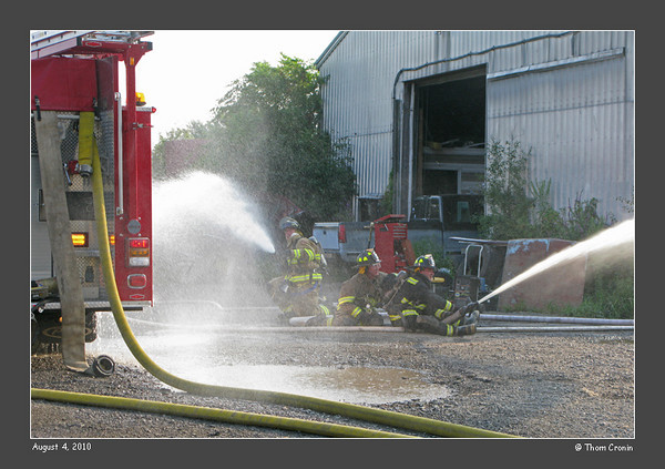 With full water pressure restored, crews concentrate on cooling the apparatus and protecting the exposure.