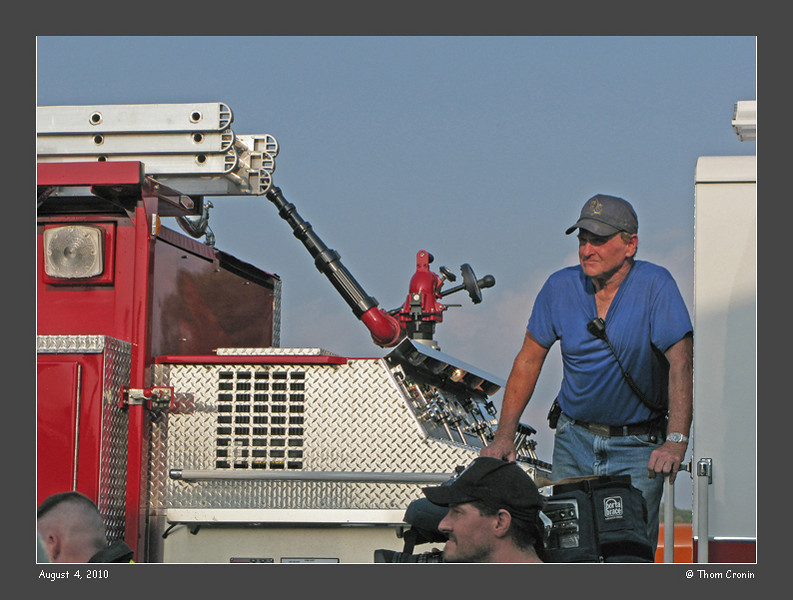 Past Chief Gary Dimke, pump operator of Engine 608 surveys the scene.