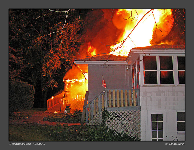 View toward the number 4 side.  Heavy fire vents from the roof above the living room area.