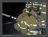 Firefighters Bob Lemin on the nozzle, and Brendan Donohue operate a 2 1/2 inch handline