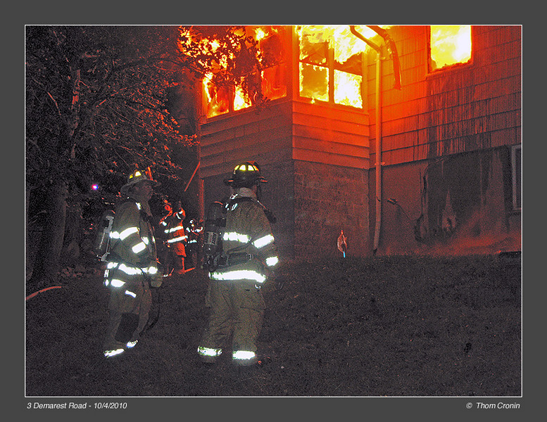 2nd Assistant Chief Joe Smith consults with firefighter John Miles.