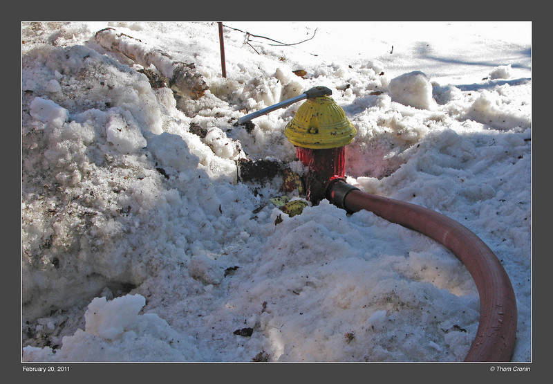 This hydrant, across the street from the fire, had to be dug out of a snow bank.