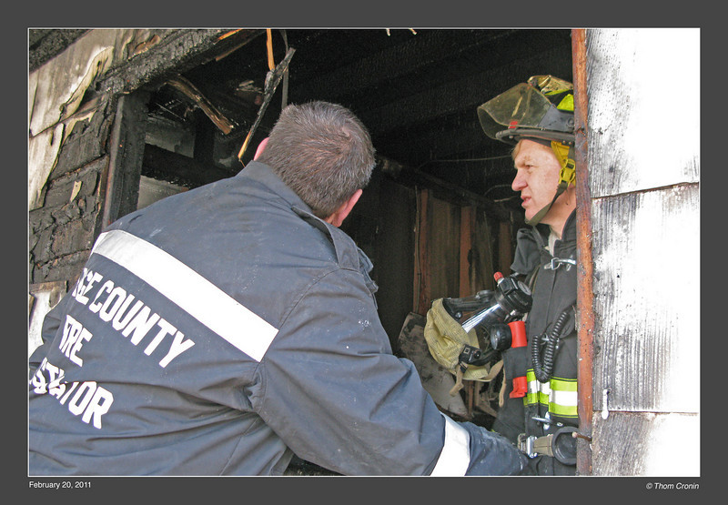 Orange County Fire Investigator George Haas searches for the cause of the fire.