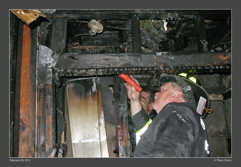 Investigators search for the cause of the fire.