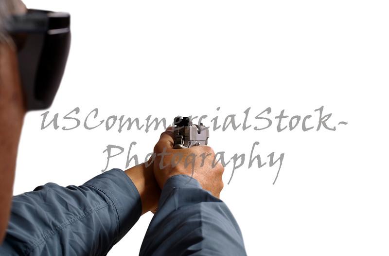 Man Aiming and Shooting Semi Automatic 45 Handgun