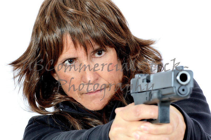 Mature Woman shooting a Handgun