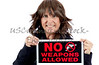 Mature Woman holding a No Weapons Sign