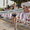 STAN HUDY - SHUDY@DIGITALFIRSTMEDIA.COM<br /> Saratoga Springs High School runner Kelsey Chmiel approaches the finish line as the three-time top female runner at Wednesday's Firecracker 4 4-mile race through historic Saratoga Springs.