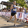 STAN HUDY - SHUDY@DIGITALFIRSTMEDIA.COM<br /> RPI grad Ben Fazio finished just two steps behind the men's champion at Wednesday's Firecracker 4 4-mile race through historic Saratoga Springs.