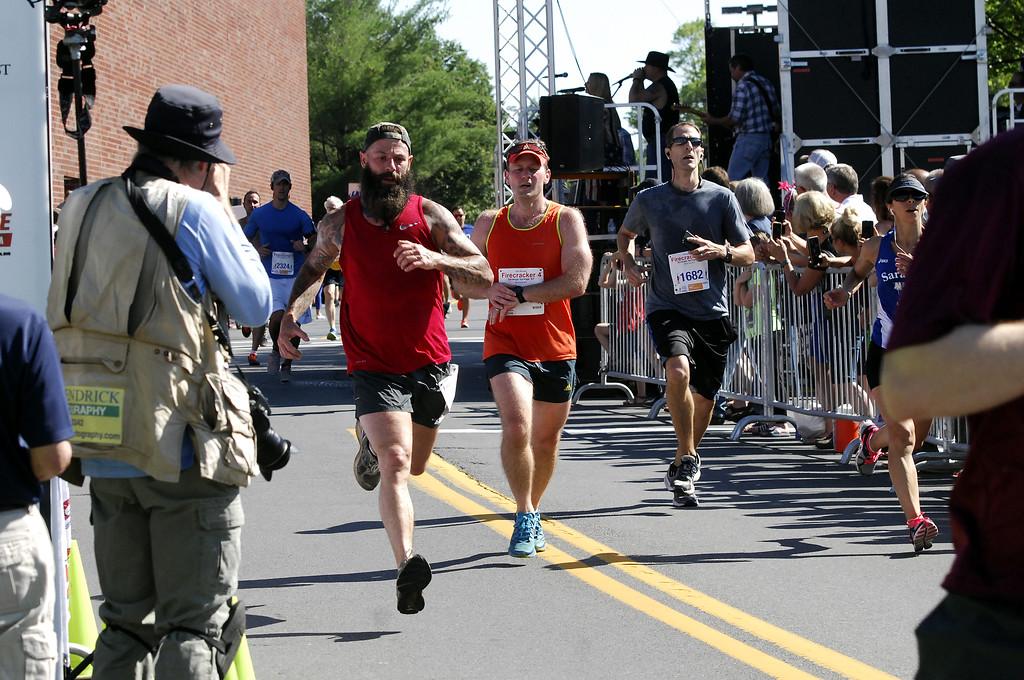 . STAN HUDY - SHUDY@DIGITALFIRSTMEDIA.COM Photos from the 11th annual Firecracker 4 4-mile race in Saratoga Springs, New York. July 4, 2017.