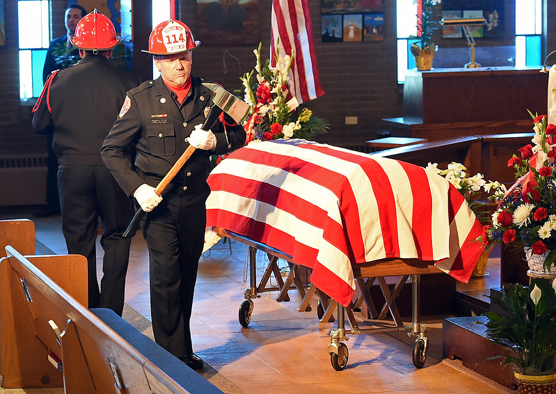 Loveland Fire Rescue Authority honor guard member John Glenn and other members prepare to post colors Wednesday, April 18, 2017, during the memorial service for former LFRA fire marshall Tim Haag at Zion Lutheran Church in Loveland.  (Photo by Jenny Sparks/Loveland Reporter-Herald)