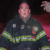 An exhausted firefighter, Tim O'Kane, takes a breather after assisting in locating a victim of the second Alm fire on Walton St. O'Kane and the other members on duty that night were honored by the Commonwealth for their bravery at the 27th Annual Firefighter of the Year Awards held at Mechanics Hall in Worcester. SENTINEL&ENTERPRISE/ Jim Marabello