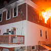 Fitchburg Fire Chief Kevin Roy checks on first in crews at a second Alm fire at 176 Walton St. on Feb. 10, as heavy fire vents from the back of the building. Chief Roy and other members on duty that night were honored by the Commonwealth for their bravery at the 27th Annual Firefighter of the Year Awards held at Mechanics Hall in Worcester. SENTINEL&ENTERPRISE/ Jim Marabello