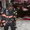 Fitchburg Lt. Jack Gilmartin exits the building after finding and removing a trapped occupant during a second Alm fire at 176 Walton St. on February 10th. Gilmartin and the other members on duty that night were honored by the Commonwealth for their bravery at the 27th Annual Firefighter of the Year Awards held at Mechanics Hall in Worcester. SENTINEL&ENTERPRISE/ Jim Marabello