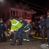 Emergency personnel wheel off one of the victims from a double fatal house fire at 176 Walton St. on Feb. 10. Fitchburg Fire Departement personnel were honored by the Commonwealth for their bravery during the fire at the 27th Annual Firefighter of the Year Awards held at Mechanics Hall in Worcester. SENTINEL&ENTERPRISE/ Jim Marabello