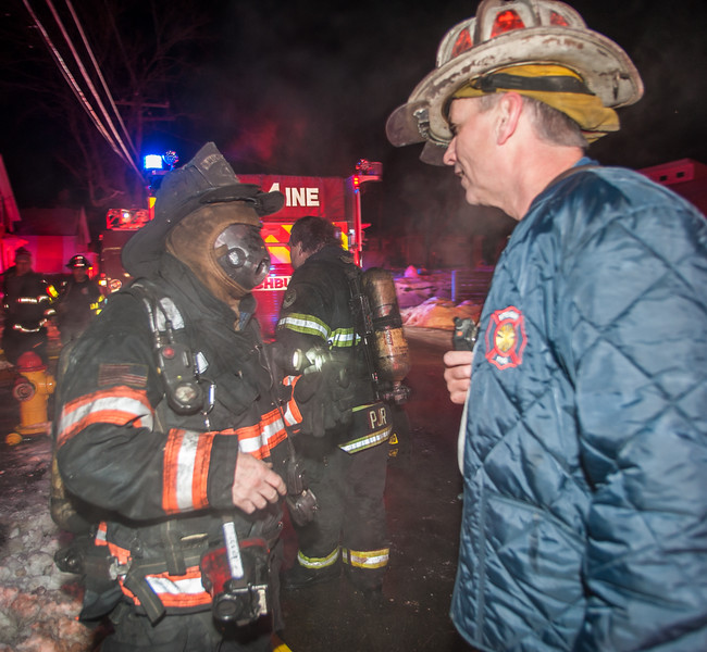 Fitchburg Lt. Jack Gilmartin confers with Chief Kevin Roy after finding and removing a trapped occupant during a second Alm fire at 176 Walton St. Gilmartin, Roy, and the other members on duty that night were honored by the Commonwealth for their bravery at the 27th Annual Firefighter of the Year Awards held at Mechanics Hall in Worcester. SENTINEL&ENTERPRISE/ Jim Marabello