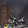 Fitchburg Firefighters Shane Thomas, left, and Patrick Haverty open the roof during a second Alm fire at 176 Walton St. on Feb. 10. Thomas, Haverty and the other members on duty that night were honored by the Commonwealth for their bravery at the 27th Annual Firefighter of the Year Awards held at Mechanics Hall in Worcester. SENTINEL&ENTERPRISE/ Jim Marabello