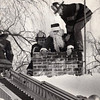 Not sure of the date of this photo. Blue Hills FD members Jack Jansen, James Ferrigno and unknown firefighter trying to rescue santa. Photo provided by James Ferigno.