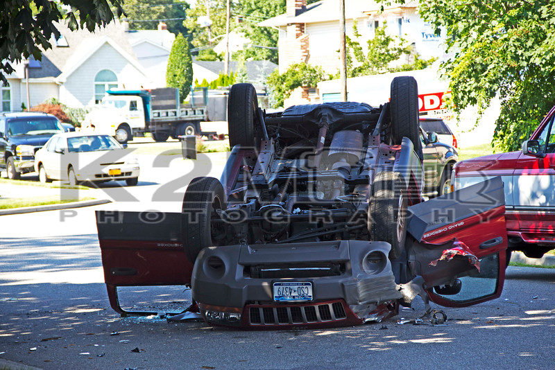 Tuesday, August 6th, 2013: the Bellmore Fire Department and Nassau County Police responded to a reported motor vehicle accident with overturn and possible entrapment at the intersection of Bellmore Avenue and Natta Boulevard.  Upon arrival first responders found the overturned auto on Herbert Court just off Natta Boulevard.  The driver self-extricated and was transported to an area hospital.