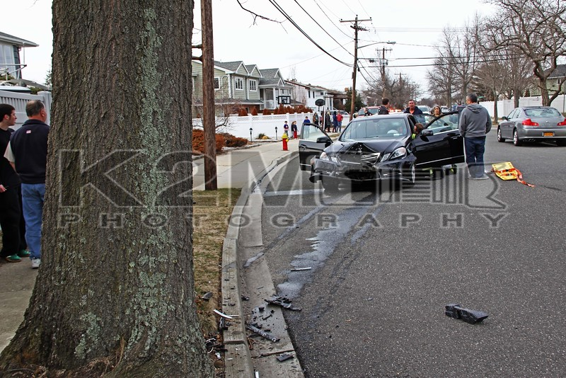 Sunday, March 17th, 2013: the Bellmore Fire Department was dispatched to a reported car versus tree in front of 2930 Shore Road.  The driver was transported by a Bellmore Fire Department ambulance to an area hospital.  Bellmore Engines 602 and 603 were on scene along with Ladder 606.  All fire department units were under the command of Bellmore Chief of Department O'Brien [600-00].