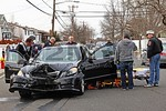 The driver of the Mercedes-Benz sedan was taken from her auto and loaded onto an awaiting stretcher.  She was transported by a Bellmore Fire Department ambulance to an area hospital.  Bellmore Engines 602 and 603 were on scene along with Ladder 606.  All fire department units were under the command of Bellmore Chief of Department O'Brien [600-00].