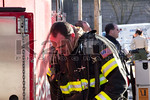 A Massapequa firefighter on the scene of a working fire on Eastlake Avenue on February 22nd, 2014.