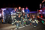 Members of Uniondale Midtown Truck on the scene of an overturned auto on the night of January 17th, 2014.